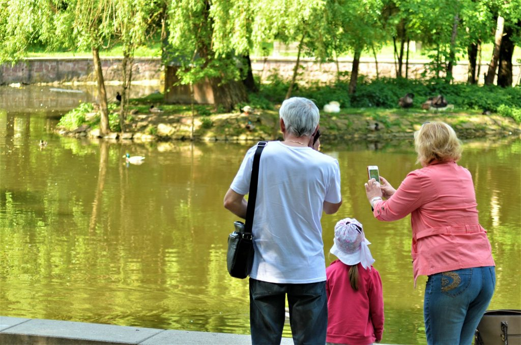 family taking photo of water during scavenger hunt