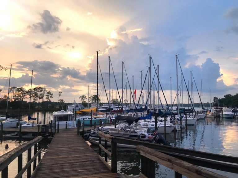 Bluewater Bay Marina dock overlooking boats at sunset